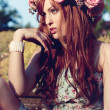 Beautfiul woman outdoor in summer with flowers on head — Stock Photo #18623165