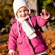 Royalty-Free Stock Photo: Cute littloe girl playing outdoor in autumn