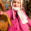 Cute littloe girl playing outdoor in autumn — Stock Photo #18625091