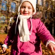 Cute littloe girl playing outdoor in autumn — Stock Photo #18625253