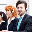 Royalty-Free Stock Photo: Smiling callcenter agent with headset support