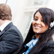 Smiling callcenter agent with headset support — Stockfoto