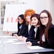Business team on table in office conference — Stock Photo #18627245