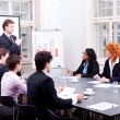 Business team on table in office conference - Stock Photo