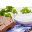 Fresh tasty herbal creme cheese and bread — Stock Photo #18627791
