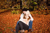 Happy young couple smilin in autumn outdoor — Stock Photo
