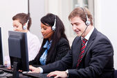Smiling callcenter agent with headset support — 图库照片