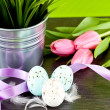Traditional easter egg decoration with tulips and ribbo — Zdjęcie stockowe