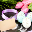 Traditional easter egg decoration with tulips and ribbo — Stock Photo