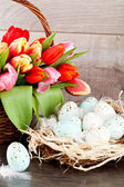 Festive traditional easter egg decoration ribbon and tulips — Stock Photo