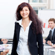 Professional successful business woman in office smiling — Stock Photo #18939609
