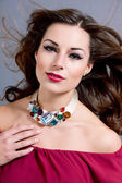Attractive brunette woman with glamour jewellry — Stock Photo