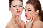 Two beautiful girls with colorfull makeup isolated — Stock Photo
