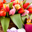 Pink present and colorful tulips festive easter decoration — Stock Photo