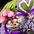 Pink tulips and brown eggs with purple ribbon easter decoration — Stock Photo #20102111