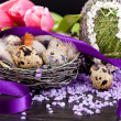Pink tulips and brown eggs with purple ribbon easter decoration — Stock Photo