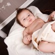 Sweet little baby infant toddler on blanket in basket - Stock Photo