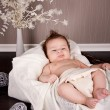 Sweet little baby infant toddler on blanket in basket — Stock Photo