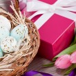 Pink present and colorful tulips festive easter decoration — Lizenzfreies Foto