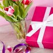 Pink and white tulips present ribbon easter birthday — Stockfoto