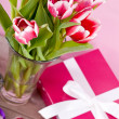 Pink and white tulips present ribbon easter birthday - Stock Photo