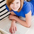 Young teenager girl with laptop smilig — Stock Photo #21238171