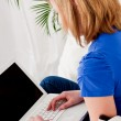 Young teenager girl with laptop smilig — Stock Photo #21239065