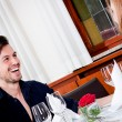 Happy smiling couple in restaurant — Stock fotografie