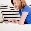 Young teenager girl with laptop smilig — Stock Photo