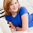Young teenager girl with laptop smilig — Stock Photo #21238111