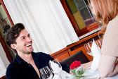 Happy smiling couple in restaurant — Stock Photo