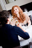 Happy smiling couple in restaurant celebrate — Stock Photo