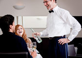 Man and woman for dinner in restaurant — Foto Stock