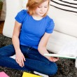 Happy teenager girl doing homework — Stock Photo #21240647