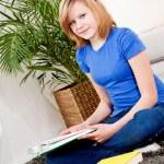 Happy teenager girl doing homework — Stock Photo #21241495