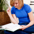Happy teenager girl doing homework — Stockfoto