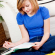 Happy teenager girl doing homework — Stock Photo #21242637