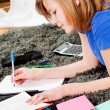 Royalty-Free Stock Photo: Happy teenager girl doing homework