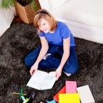 Happy teenager girl doing homework — Stock Photo #21244257