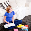 Happy teenager girl doing homework  — Stock Photo
