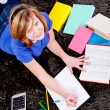 Happy teenager girl doing homework — Stok fotoğraf
