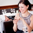 Stock Photo: Dinner in restaurant mand wompay by credit card