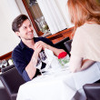 Happy smiling couple in restaurant — Stock Photo