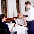 Man and woman in restaurant for dinner - Stock Photo