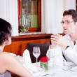 Happy smiling couple in restaurant — Stock Photo #21461363