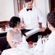 Man and woman in restaurant for dinner — Stock Photo