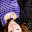 Happy teenager girl listening to music — Stock Photo #21469107