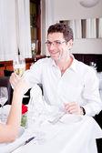 Happy smiling couple in restaurant celebrate — Stock Photo