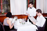 man and woman in restaurant for dinner — ストック写真