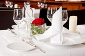 Tables in restaurant decoration tableware empty dishware — Stock Photo